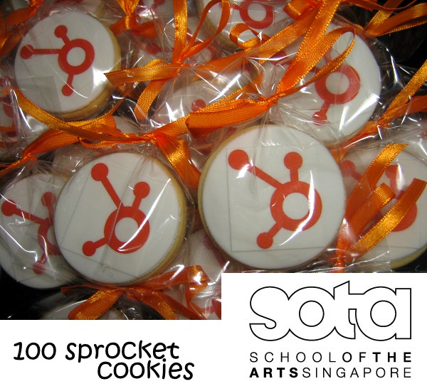 100 Sprocket logo round cookies